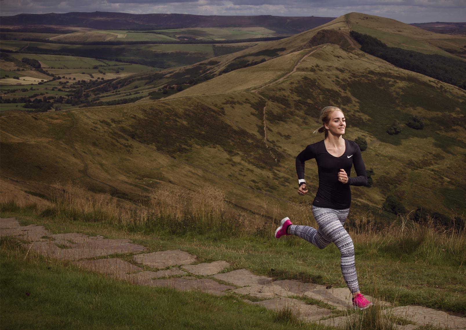 female runner on Mam Tor, Peak District
